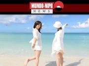 Mulheres tomando sol em uma praia no Japão