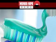 Creme dental sendo colocado em uma escova de dentes