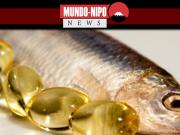 Peixe ao lado de cápsulas de omega 3