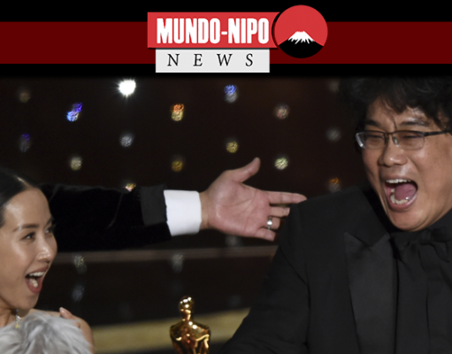 Bong Joon-ho, à direita, reage ao receber o prêmio de melhor filme