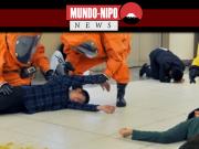 Equipe de emergência participa de simulação contra ataque de gás sarin em estação de metrô de tokyo